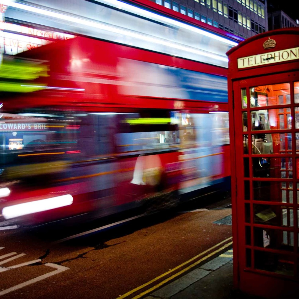 A London bus passes a telephone box on Haymarket.